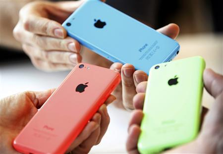 Apple shares drop after unveiling the iPhone 5C and 5S.