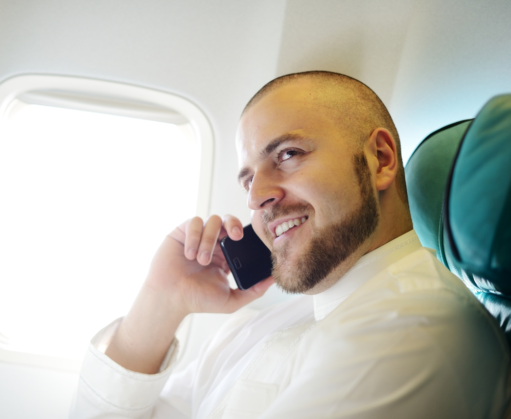 Gogo app enables airplane passengers to call and text .